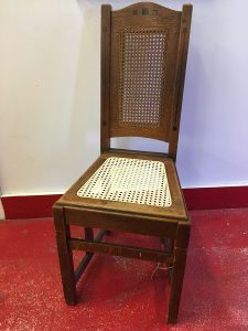 A regular sized pressed cane chair seat